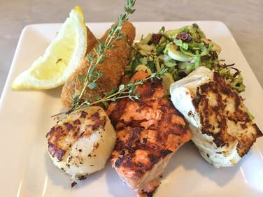 Mixed Seafood Grill with Wild Halibut, King Salmon and Scallop.