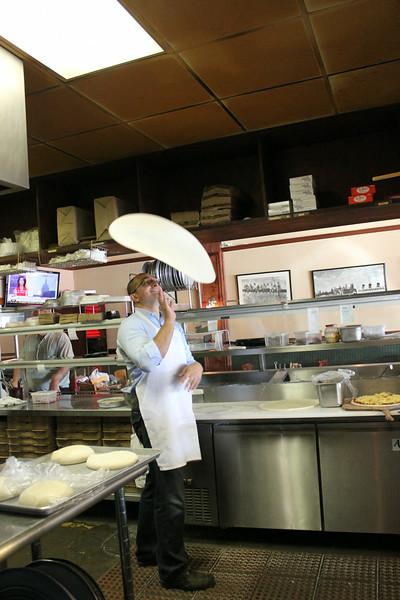 Dough toss at Primo Brothers via dallasfoodnerd.com