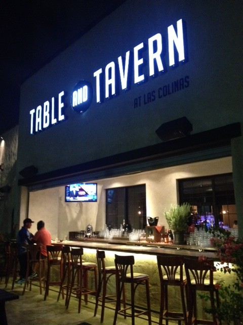 table and tavern lively outdoor patio via dallasfoodnerd.com
