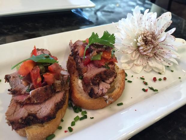 Four peppercorn crusted beef tenderloin via dallasfoodnerd.com